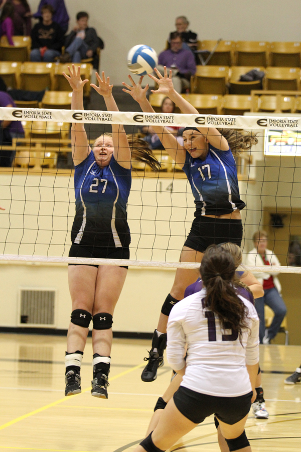 as teammate  Savanna Wuest (26) prepares for a possible block. RIGHT PHOTO: Ceira Nolte (27) and Brittney Hiebert go for the block during the same match
