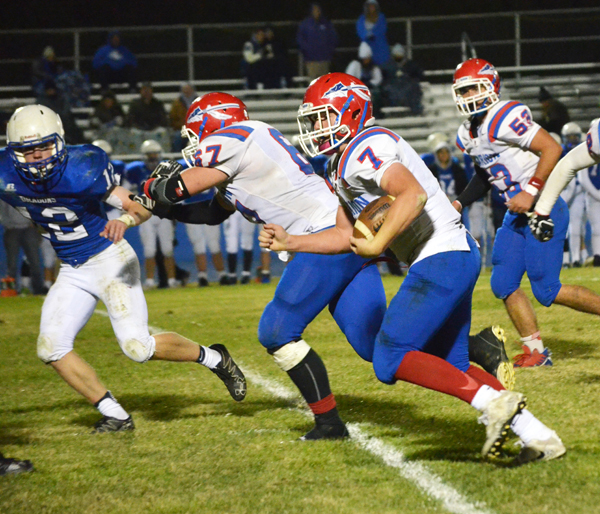 Evann Heidebrecht rushes for positive yardage during the second half of Marion's 54-30 bi-district win at Halstead Tuesday. Heide­brecht led all rushers with 30 carries for 255 yards and four touchdowns. Janae Rempel