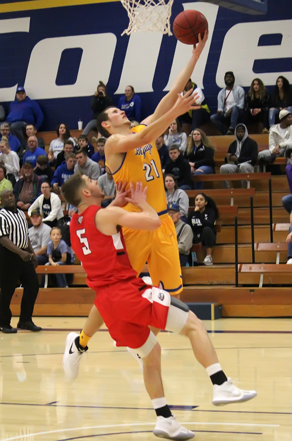 Tabor's Jordan Horstick drives for two of the nine points he scored during Saturday's 85-71 win over McPherson College. This was Horstick's second start of the season.
