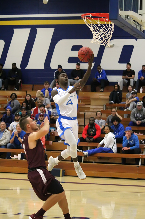 TC men open hoops season with two losses