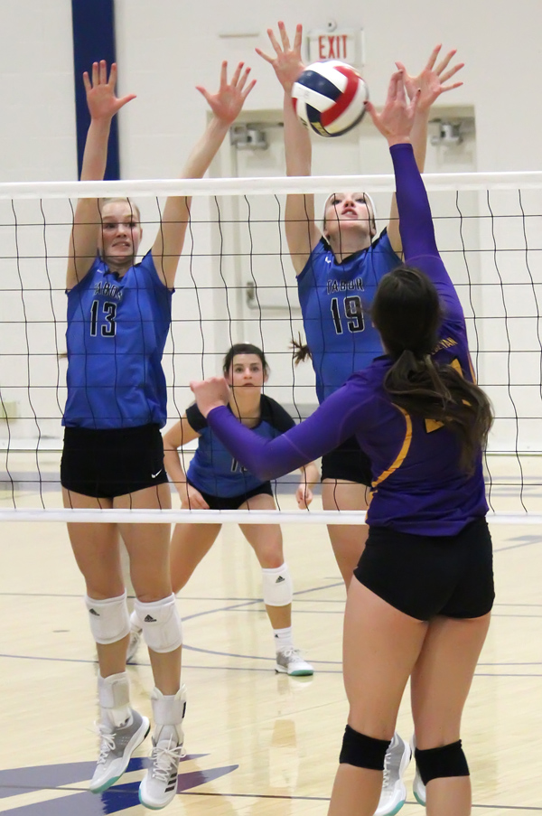 Tabor frontliners Sydney Peitz and Amy Horner go for the block against Kansas Wesleyan Friday at Tabor. The Bluejays swept the KCAC-leading Coyotes, 3-0.