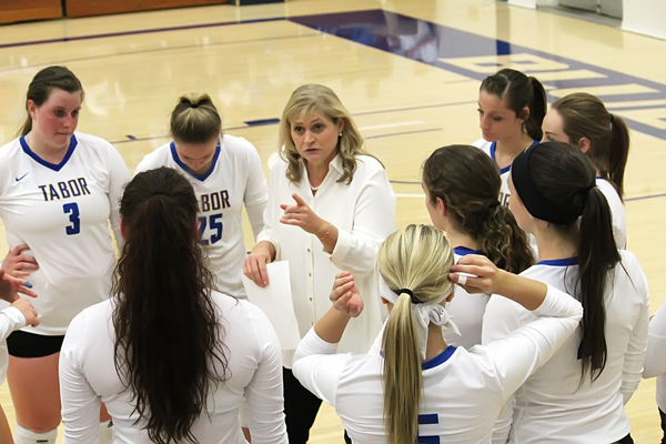 MOVING ON; Tabor College earned a trip to the NAIA Volleyball Championships by defeating Trinity Christian College before a home-court crowd.