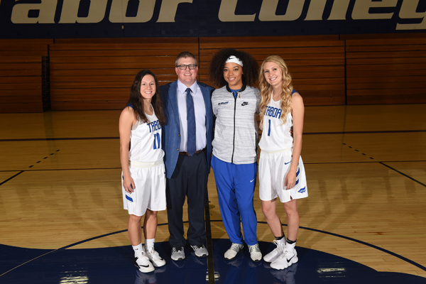 Coach Shawn Reed is retooling with the help of three key seniors: (from left) Mollie Hawkins, Deanna Manning and Amber Bonham. Preseason favorites to win the KCAC title, the Bluejays are off to a 3-0 start so far.