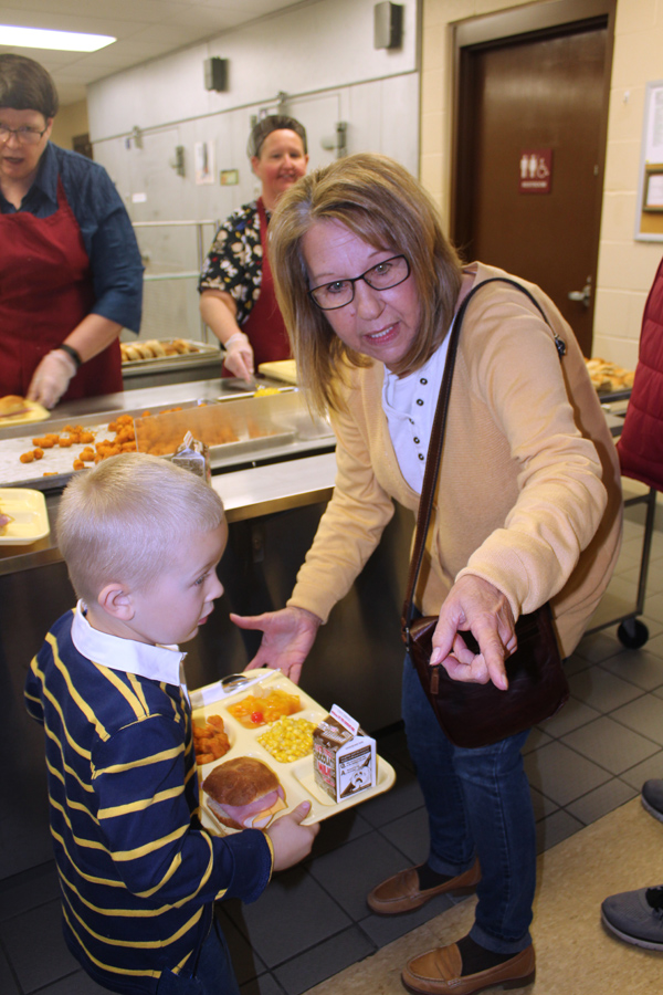 Rose Stimac and grandson Wesley Fenske look for a place to sit to enjoy their meal and their visit.