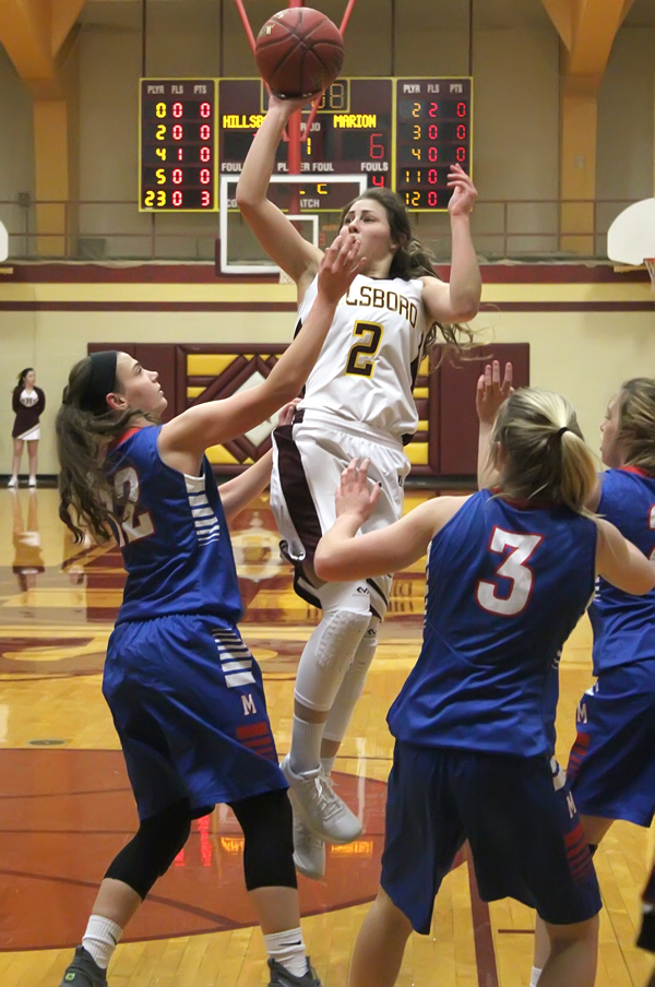 Hillsboro senior Sienna Kaufman scores two of her eight points during the first quarter of Tuesday's game with Marion. The Warriors won the game, 36-35, on a basket by Alli Molleker in the final seconds of the game.