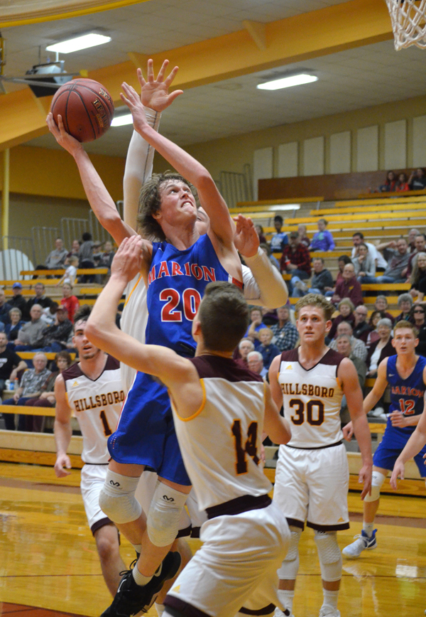 Noah Dalrymple draws a foul during the second quarter with Hillsboro Tuesday. He made one of two free-throws to give Marion a 17-15 lead. Dalrymple scored three points and pulled down seven rebounds in the game.