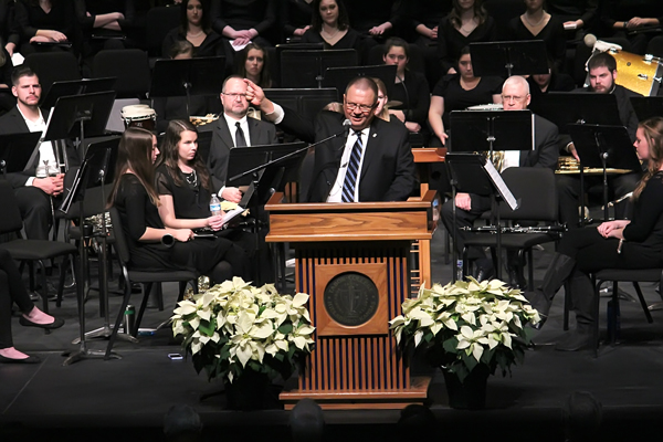 """President Jules Glanzer reviews the long history of wanting a new auditorium on campus. He also spoke of the challenge of raising adequate funds, and thanked the many donors who contributed. """"Together with God's help, we did it,"""" he said in closing."""