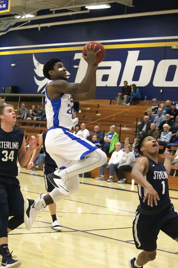 Tabor sophomore Diontre Cutliff drives for two of his 12 points in the Bluejays' 93-68 win over Sterling College on Dec. 12. It was Tabor's sixth consecutive victory.<p>