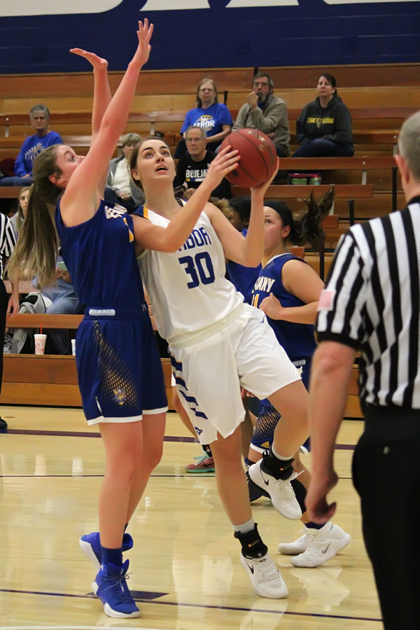 Tabor post player Kelsey Unruh drives for two of her six points against Bethany. The Swedes rallied late in the game to upset the formerly unbeaten Bluejays.