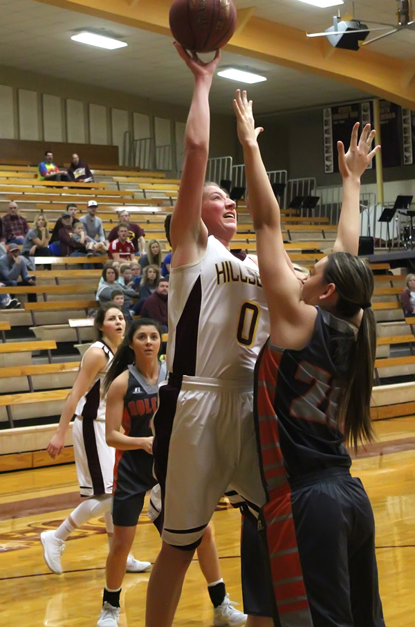 Abby Sechrist shoots for two points early in the Trojan Classic third-place game on Saturday. The senior scored eight points, pulled down eight rebounds and blocked five shots, but the Longhorns prevailed, 48-35.