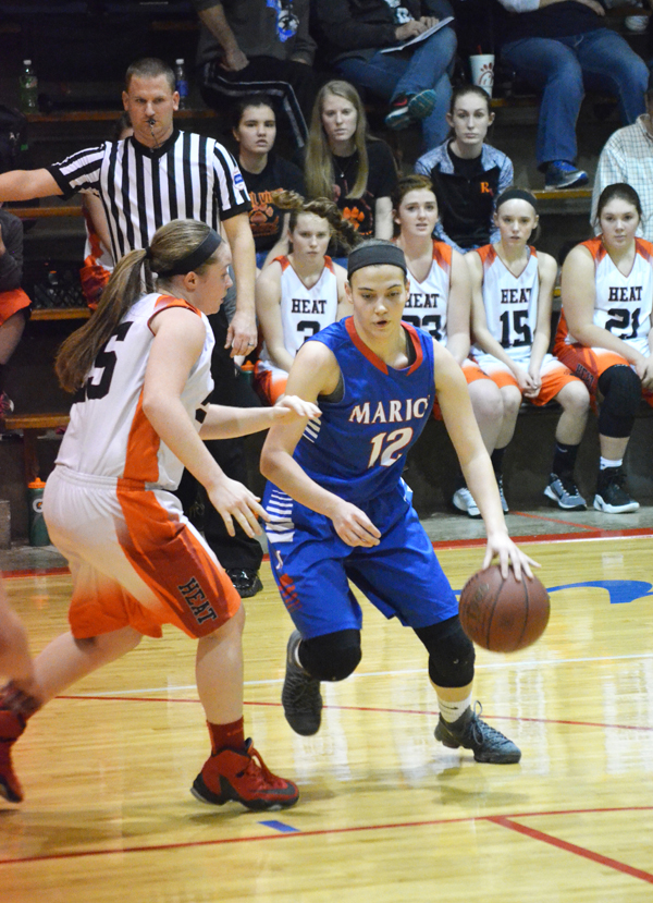 Alli Molleker dribbles past a Rural Vista defender during the first half of Saturday's championship game. Molleker scored seven points in Marion's 49-42 victory.