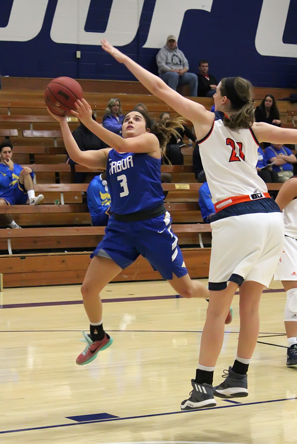 Taylor Deniston scores two of her 20 points in Saturday's loss to Hastings College on Saturday. Deniston scored 19 points to lead the Bluejays to a 74-70 win over Valley City State on Friday.