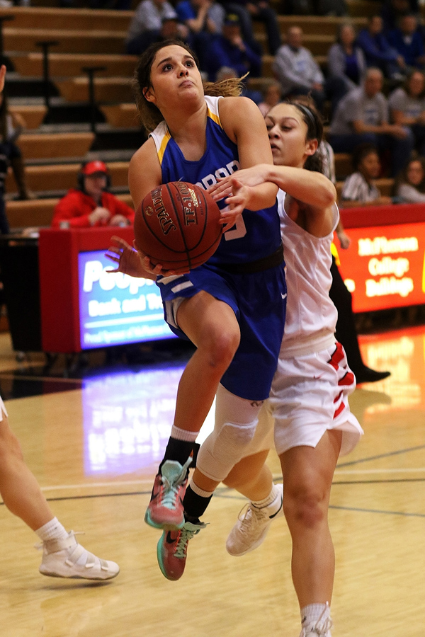 Taylor Deniston draws a foul and during the second quarter of the Bluejays game against McPherson on Saturday. She made both free throws she was awarded.