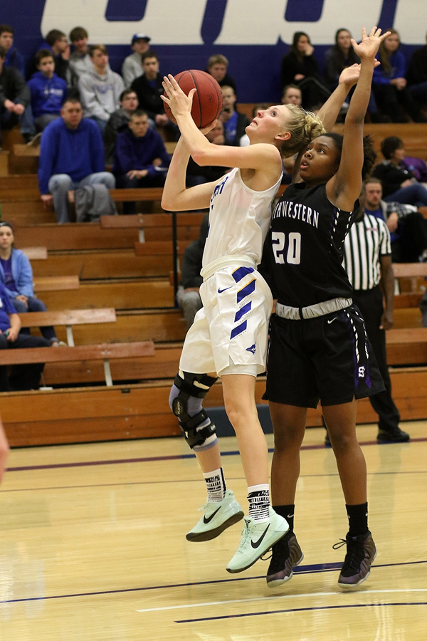 Bluejay guard Amber Bonham is fouled by Makala Canada of Southwetern during the third quarter of Tabor's 78-63 victory. Bonham finished 18 points, teammate Taylor Deniston added 19, Sammy Jo Peterson 16 and Tristen Leiszler 11. / Phyllis Richert photo