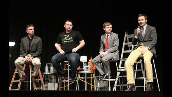 The four high-school age gubernatorial candidates wait to share their views. From left: Alexander Klein (standing in for Jack Bergerson of Wichita); Ethan Randleas, a Libertarian candidate from Wichita; Tyler Ruzich, a Repub­li­­can from Prairie Village; and Dominic Scavuzzo, a Republican from Leawood.