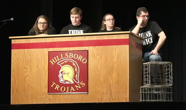 Think Twice members wait for their opportunity to share questions submitted by Hillsboro students. Seniors from Marion, Centre and Goessel high schools participated in the forum, and contributed questions as well.