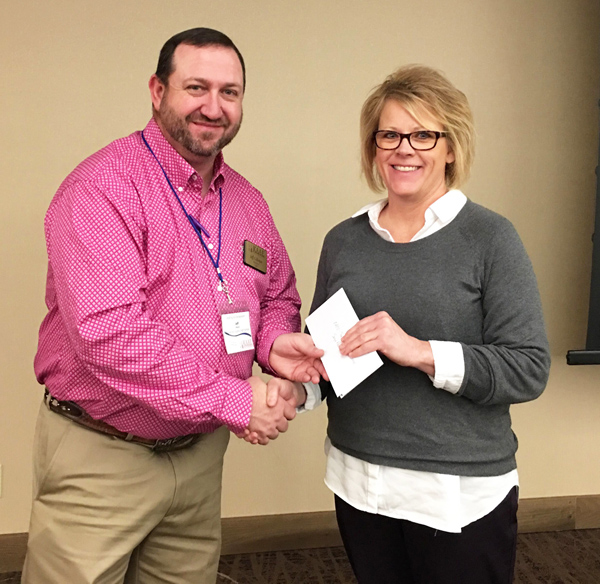 Gillespie presents the Community Service Award to Sonya Roberts, Hillsboro High School agriculture instructor, during the KAAE annual symposium in Lawrence Jan. 27.