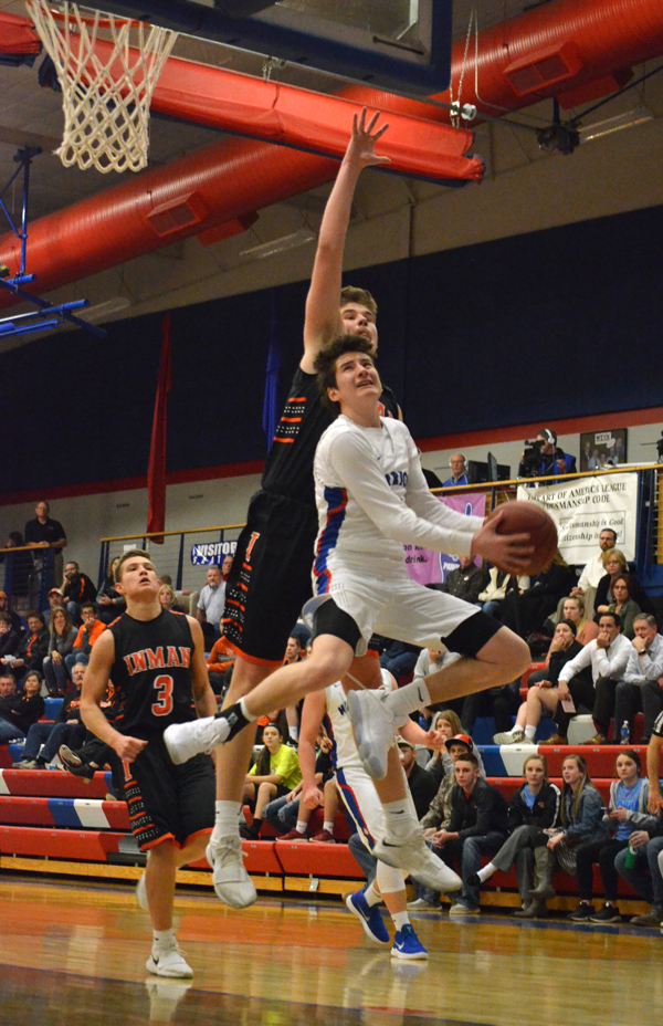 Sam Zinn shoots for two during the second half of Tuesday's game with Inman. Zinn scored 12 points in Marion's 58-53 win.