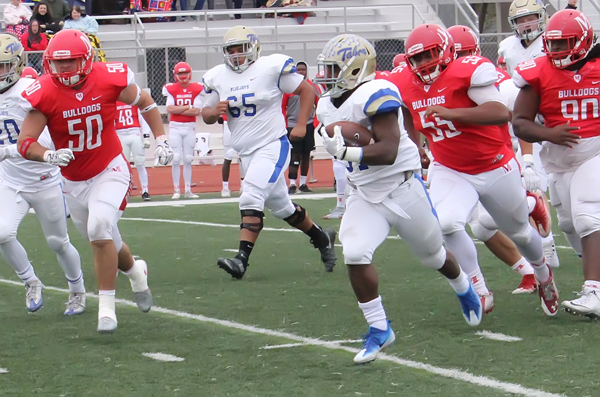Tabor College standout running back Drevion Cooper runs for a 48-yard gain during the Bluejays' win over McPherson. Tabor claimed a record third-straight KCAC title in 2017.