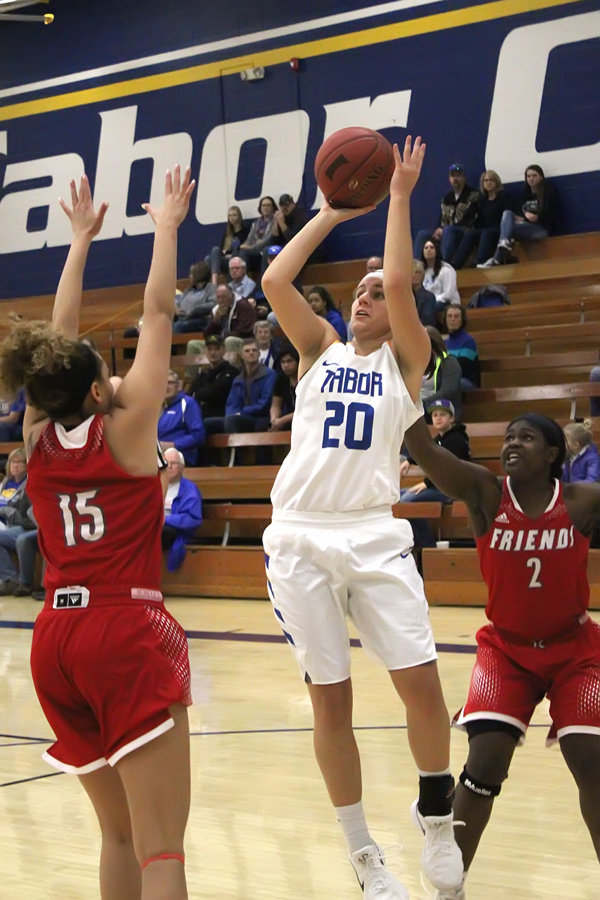 Tristen Leiszler shots for two of her 16 points during Saturday loss to Friends University, the KCAC leader. Leiszler led the Bluejays with 16 points.