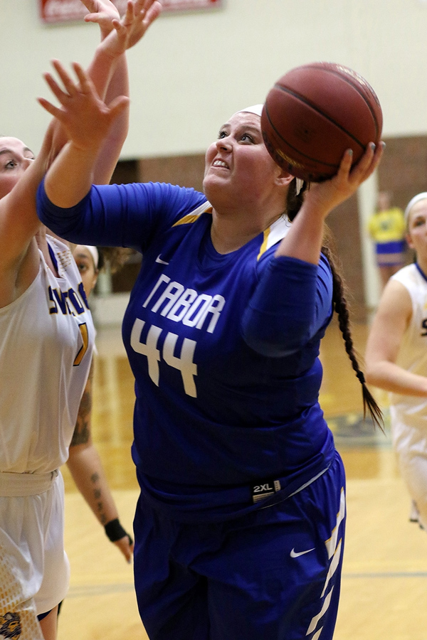 Tabor Bluejay forward Taylor Mires scores two points in the second quarter of Tabor's 73-56 defeat at Lindsborg on Saturday. The Bluejay women, picked to be a contender for a KCAC title, have struggled through five consecutive defeats as the season heads for the finish line.