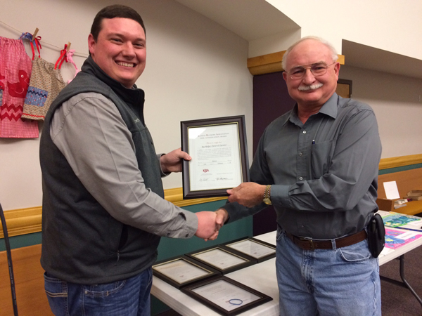 Ray Redger of Newton receives his Kansas Bankers Water Quality Award from Tyler Ottensmeier.<p>