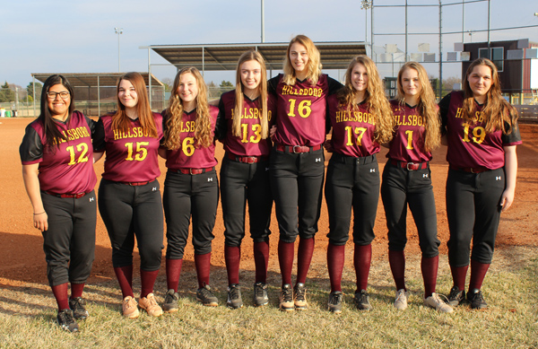 With a returning core of nine returning letter-winners and seniors, Trojan softball coach Stephanie Sinclair aims to improve on last season's 3-18 record. Pictured are (from left) Maria Nieto, Sam Moss, Cheyenne Bernhardt, Taylor Helmer, Elli Weisbeck, Sarah Jost, Ava Weisbeck and Kylee Martin. Not pictured: Trinity Marler.