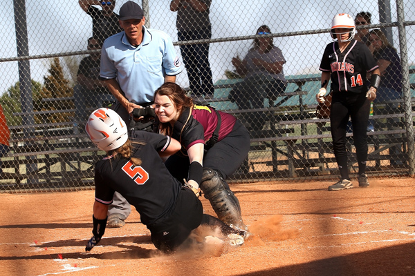 Hillsboro catcher Sam Moss tags out Larned's Shaylee Martin on a perfect throw from Trojan shortstop Dani Klein in the top of the fifth inning of Game 1 versus the Indians. Larned overcame an 8-6 deficit going into the seventh inning for a 12-8 win over the Trojans, who are now 3-1 for the year.