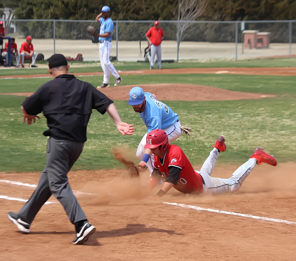 Tabor College first baseman Cameron Pope puts the tag on a McPherson baserunner during a pick-off attempt, but not in time to record an out during the Bluejays' 11-6 win in Game 1 of Tabor's Friday doubleheader. Tabor went on to win the nightcap on Friday and then completed the three-game sweep on Sunday afternoon.