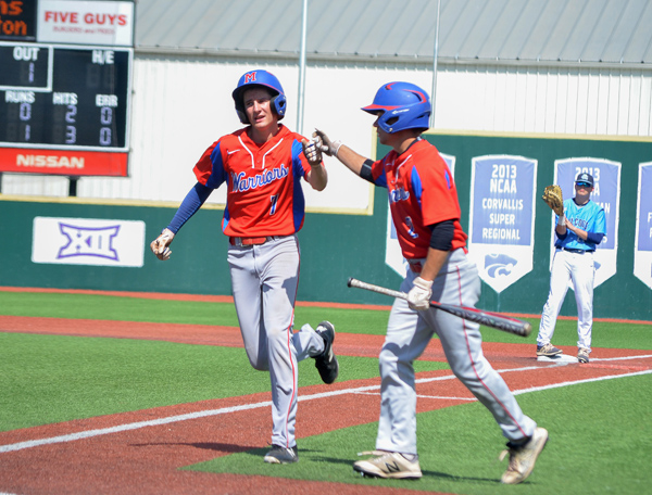 Sam Zinn (left) hit a sacrifice fly that scored Cole Srajer, who had hit a leadoff triple during the third inning with Riley County. Janae Rempel