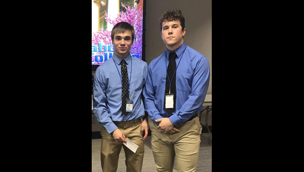 Cole Srajer (left) and Max Svoboda, shown here after winning the Marion County Youth Entrepreneurship Challenge in March, received $2,000 for their business pitch at the state contest April 27 in Manhattan.