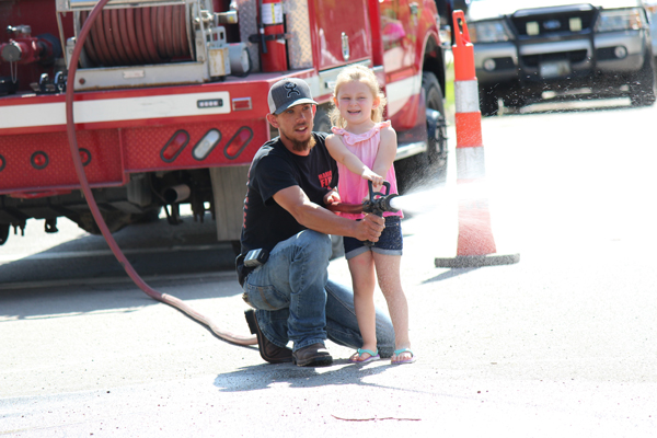 Young fans enjoyed one of the new events at Chinga­wassa Days, the Kids Firefighter Combat Challenge, organized by the local fire department.