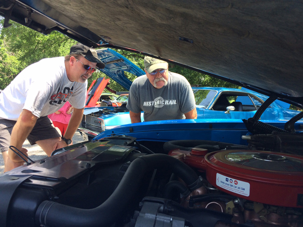 ohn Budke, a 1971 Hillsboro High grad, and his son-in-law, Heath Carlson, peer under the hood of Carlson's 1968 Oldsmobile 442, which received one of the Top 10 awards at the car show in Hillsboro on Saturday,