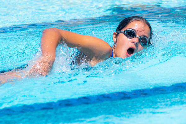 Hillsboro's Violet Klein finds her stroke during the freestyle relay for 11-12 year-old girls at the Council Grove swim meet on Saturday. Photo by Karrie Rathbone