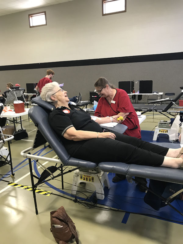 Betty Seibel visits with Red Cross employee, Pam Cooke, as she donates blood at the Red Cross Community Blood Drive. Her latest donation brings her total amount of blood donations to six gallons. Betty has been donating for over 35 years. Laura Fowler Paulus / Free Press