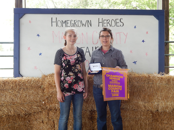 Courtesy Photo Corin Parmley and Cailey Barney- Senior Sheep Showman Grand and Reserve Grand Champion.