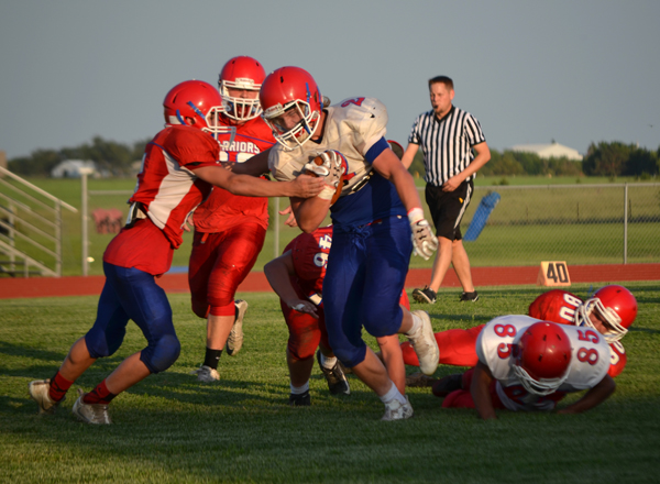 Jaxton Tracy sheds a tackler during Friday's scrimmage. Janae Rempel / Free Press