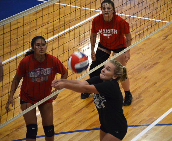 Chloe Burkholder digs a ball out of the net during Friday's scrimmage. Janae Rempel, Free Press
