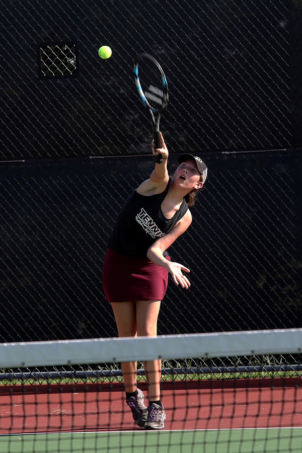 Callie Bernhardt serves up a point in her second match during the Hillsboro Invitational tennis meet at the sports complex on Tuesday. She went on to take 2nd place in #2 Singles division. Phyllis Richert