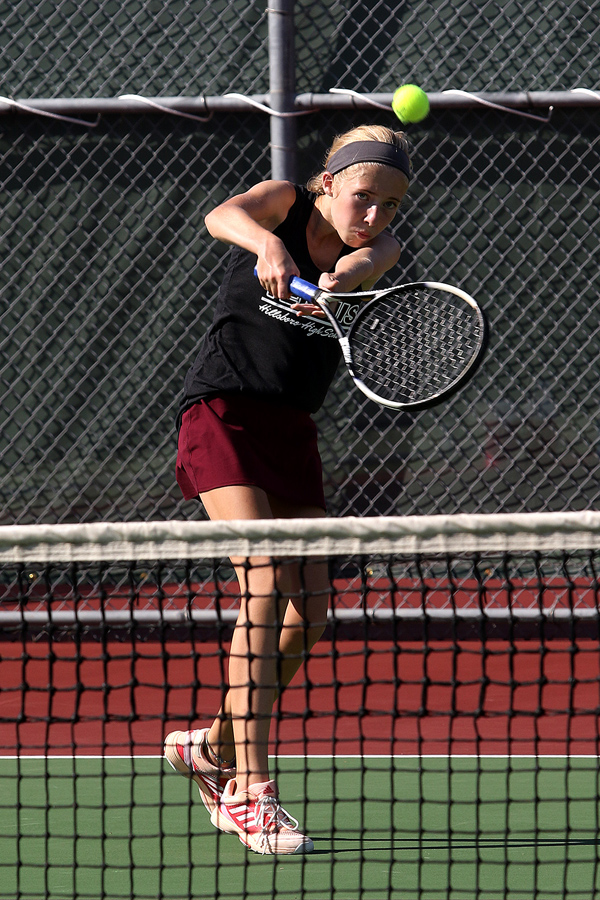 Kyla Isaac returns the ball during competition at the Hillsboro Invitational tennis meet on Tuesday. She and her partner Cheyenne Bernhardt won 2nd place in the #1 Doubles division. Phyllis Richert