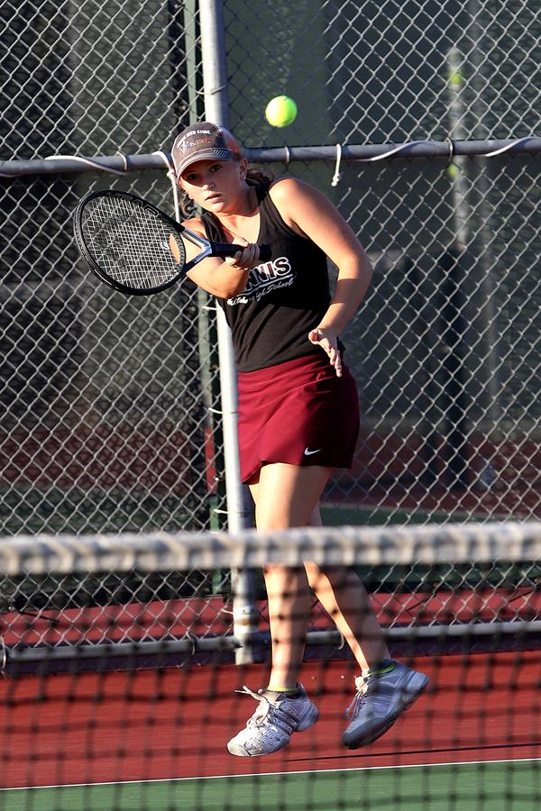 Cheyenne Bernhardt hits a volley in the tennis tournament last week hosted in Hillsboro. Phyllis Richert