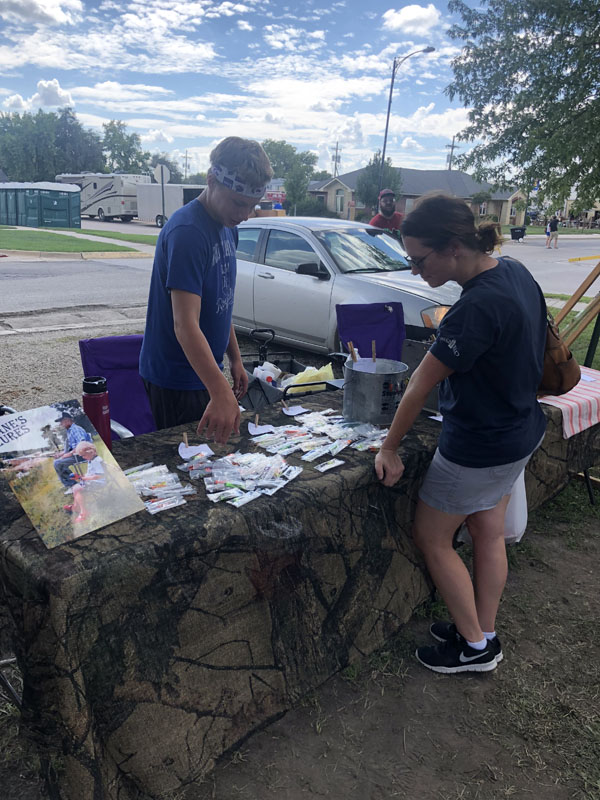 Lane Rogers helps his customer Becky Suderman as she chooses what lures she wants. He had a booth near the Hillsboro Arts and Crafts Fair on Sept. 15 and did well in sales. Laura Fowler Paulus / Free Press
