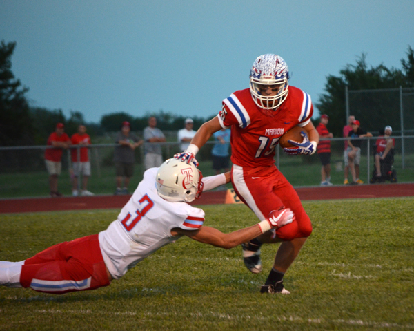 Marion falls to Hutchinson Trinity in opener
