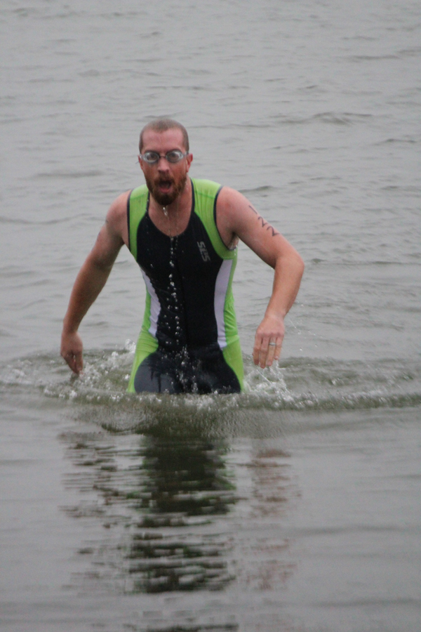Matt Spooner emerges from the cold water. He finished first in the swim and third overall. This was his first outdoor triathlon. Laura Paulus / Free Press