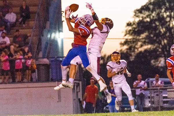 Marion's Sam Zinn intercepts a pass from Hillsboro's Jorge Hanschu to Darian Ratzlaff in the second quarter of the game on Friday night. Karrie Rathbone