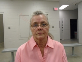 Huffman charged with embezzlement