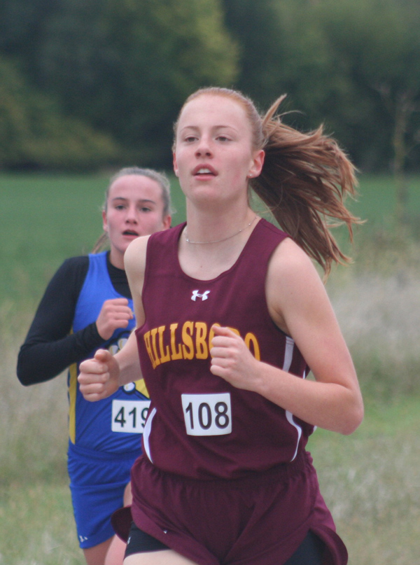 Emerysn Funk finished well in spite of the rain. She came in at 8th place for varsity girls.