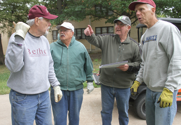 Ken Neufeld, who was an optometrist for many years in Hillsboro, second from left, works with other volunteers on Thursday, Oct. 4, at Bethel College in North Newton. Also pictured, from left, are Byron Ediger, Ron Peters and Delon . Wendy Negent / Free Press