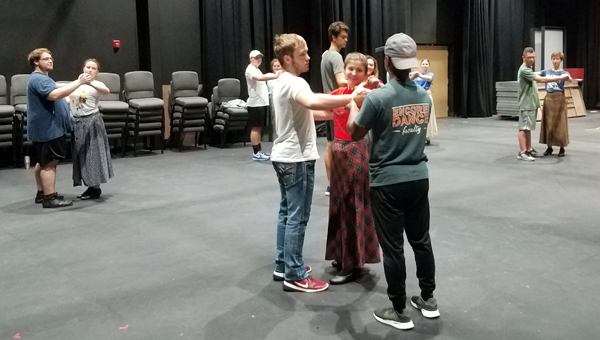 "The 'My Fair Lady"" casts rehearses a dance scene in preparation for the show's debut at 7 p.m. Thursday, Oct. 18."