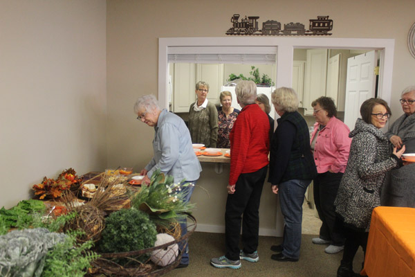 Women enjoyed the warm meal provided by the FamLee Bakery in Newton.